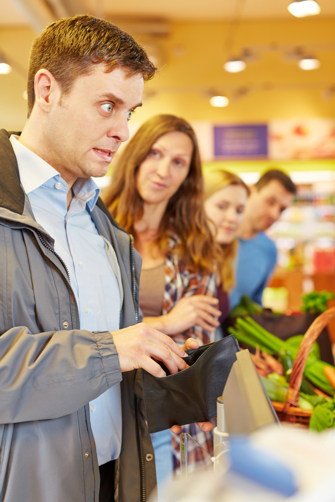 man_at_supermarket_shutterstock_338285441